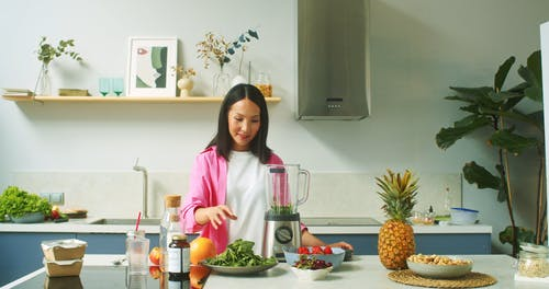 A Woman Making a Smoothie