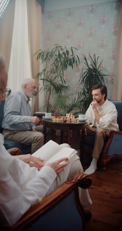 Father Playing Chess with His Son