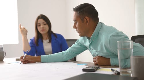 Man Discussing To A Woman About Work Plan