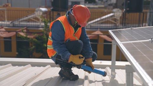 Man Safely Installing Solar Panels