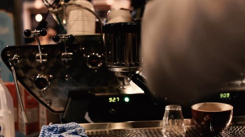 A Barista Preparing Coffee