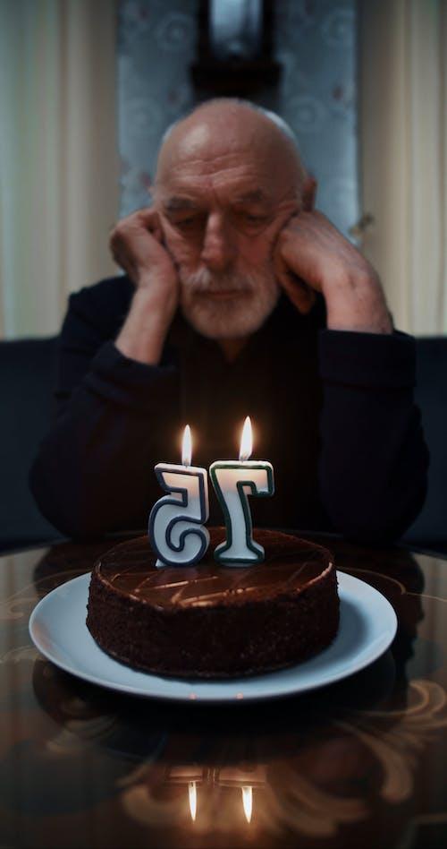 Man Blowing His Cake