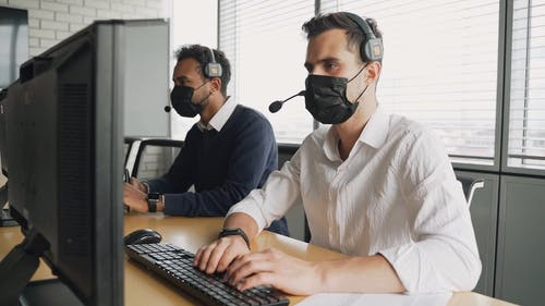 Men Wearing Face Mask While Working at the Office
