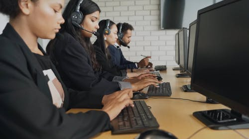 Call Center Agents Typing on Computers