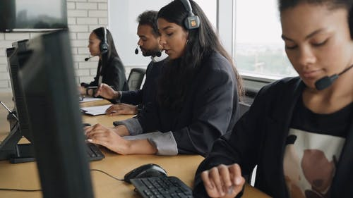 Call Center Agents Talking at an Office