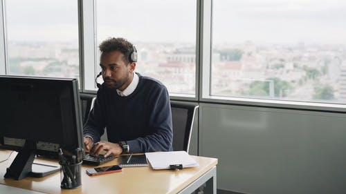 A Man Working while Wearing Headset