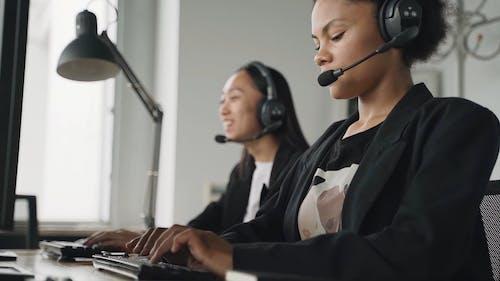 Women Working while Having Conversation