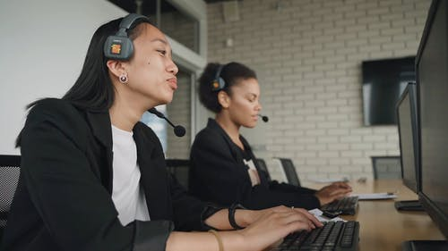 A Call Center Agents Taking a Call