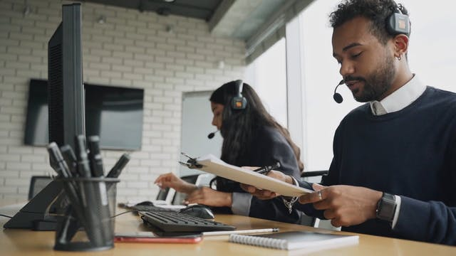 A Call Center Agents Talking To Their Clients
