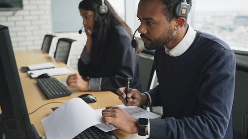 A Man and a Woman Working in a Call Center