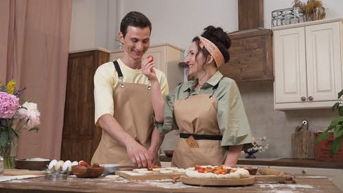 A Man and a Woman Cooking Together