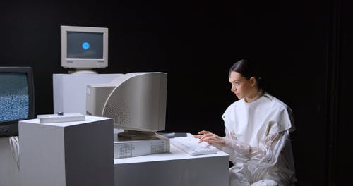 A Woman Working with a Desk Computer