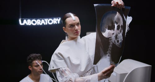 A Woman Looking at a Head X-ray