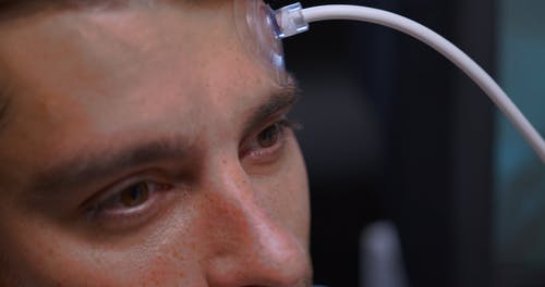 Placing Suction Cups on a Mans Forehead