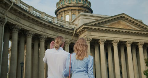 A Couple Walking while Looking at the Tourist Attraction