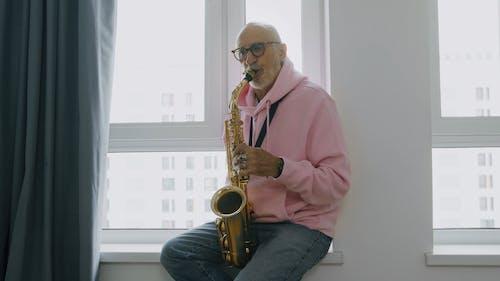 A Man Playing a Saxophone