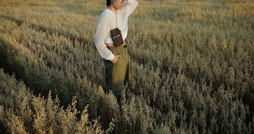 Male Model Standing on a Wheat Field