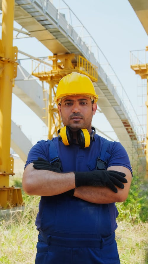 An Engineer Man Standing while Looking at the Camera