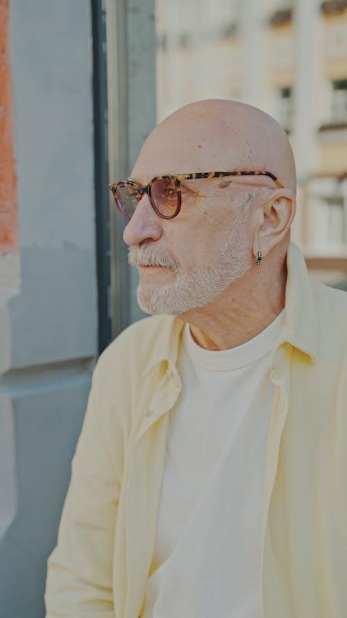 An Elderly Man Drinking Coffee