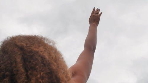 A Woman Raising Her Hand