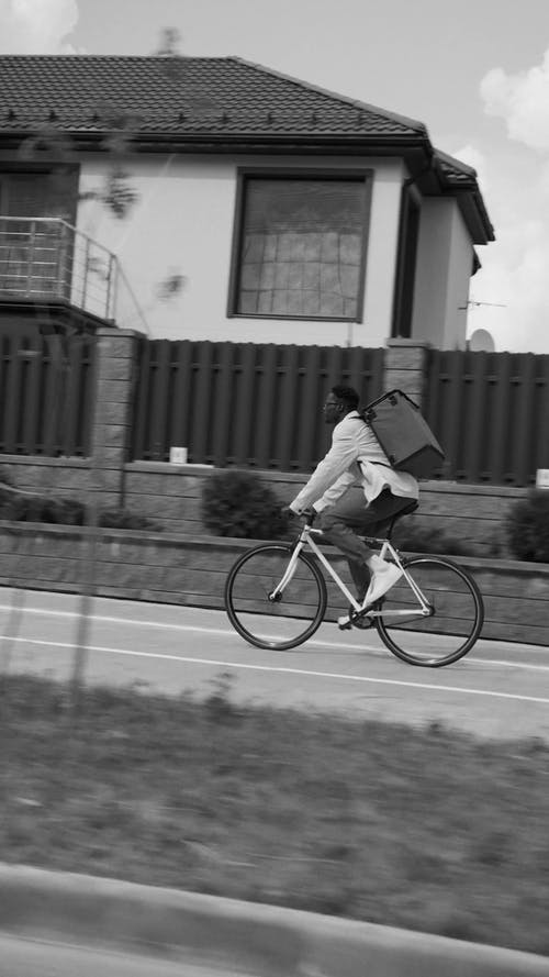 A Delivery Man Riding His Bike