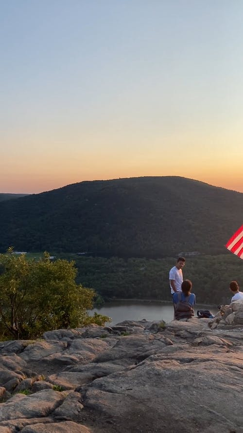 Hikers on Top of a Mountain During Golden Hour