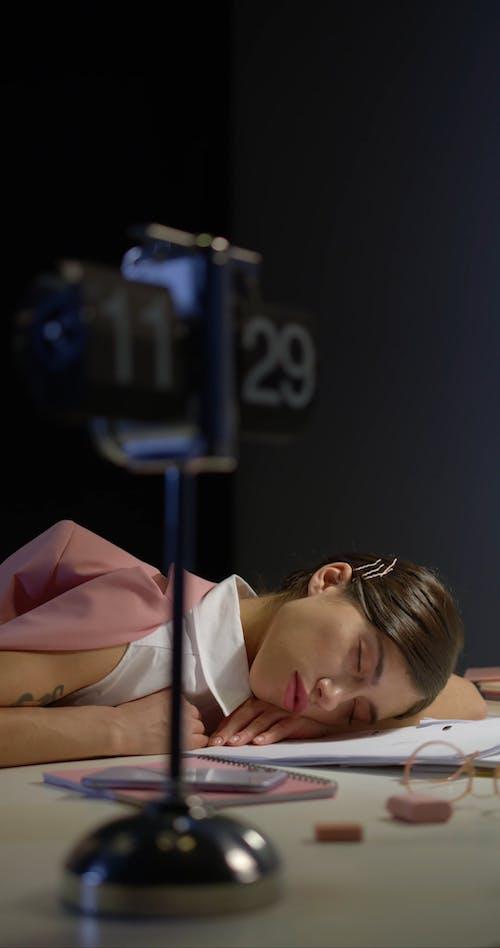 A Woman Sleeping on her Work Desk