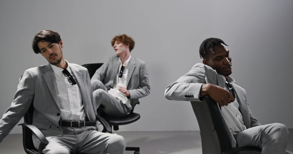 A Bored Men Spinning Their Chairs