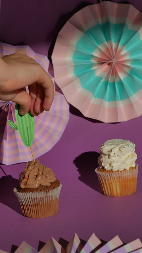 A Person Decorating the Cupcakes