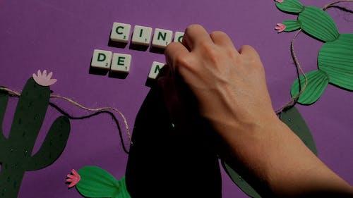 Scrabble Tiles on Purple Background