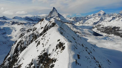 A Drone Footage of Snow Capped Mountains
