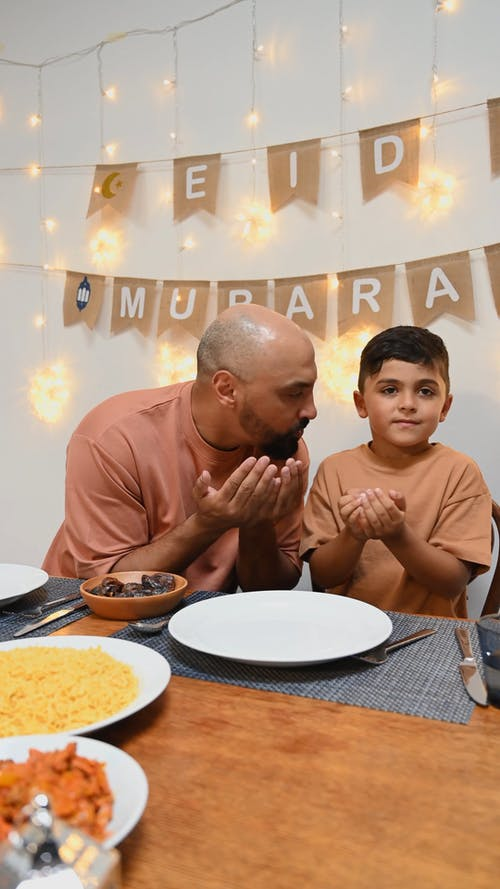 A Father and Son Praying Before Eating