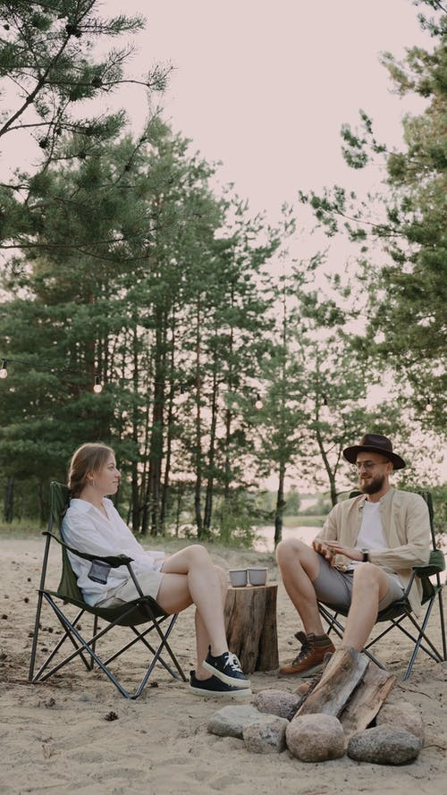 A Couple Chilling on a Campsite