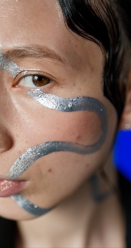 Close up of a Woman with Metallic Face Paint