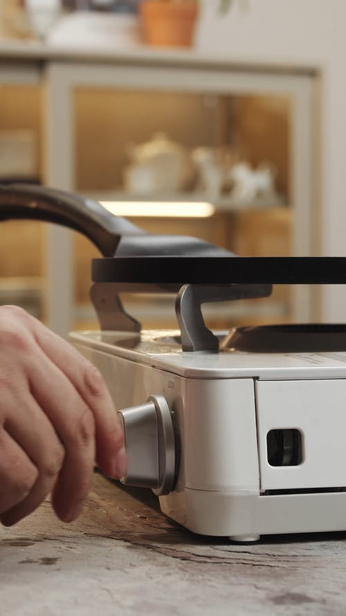 A Person Lighting a Gas Stove