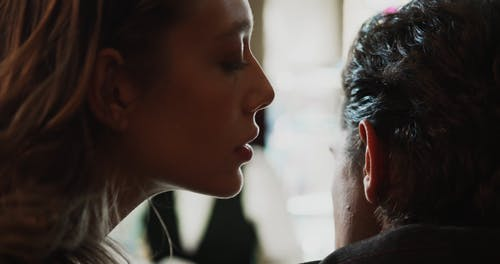 Close up of a Woman Whispering to a Man