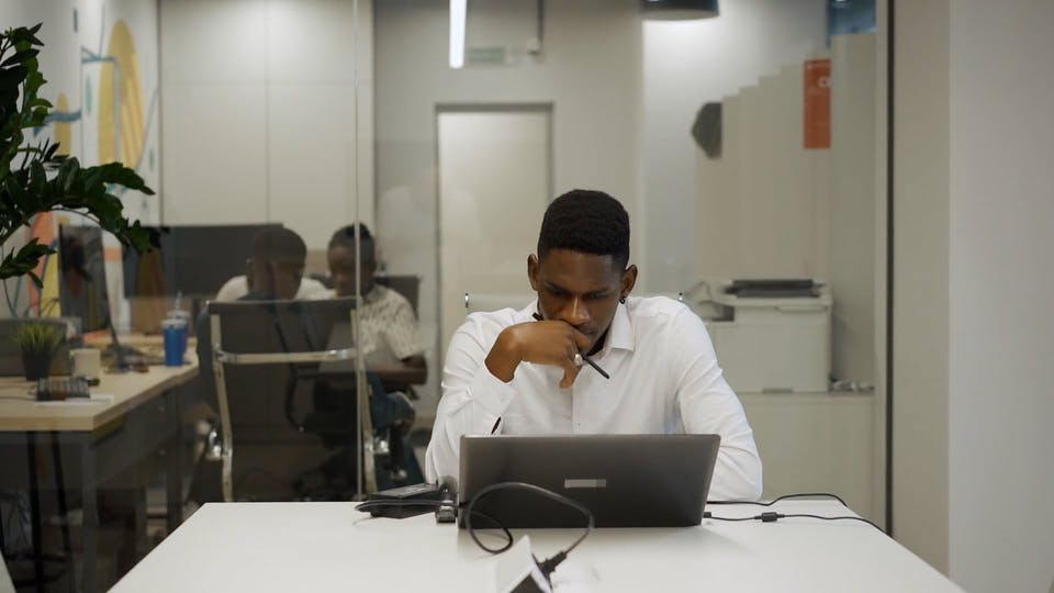 Man Looking At His Laptop In Deep Thoughts