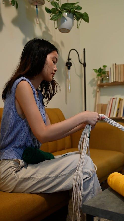 Woman Tying Yarn on Threads