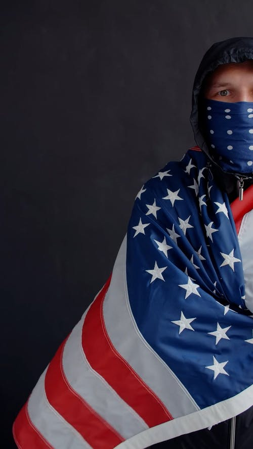 A Person Wrapped in American Flag