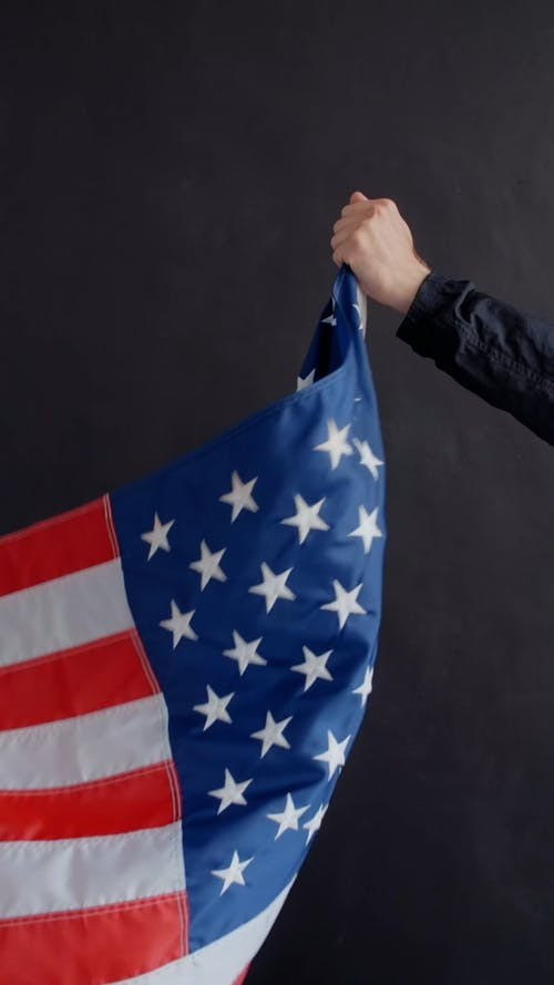 A Hand Pulling the American Flag