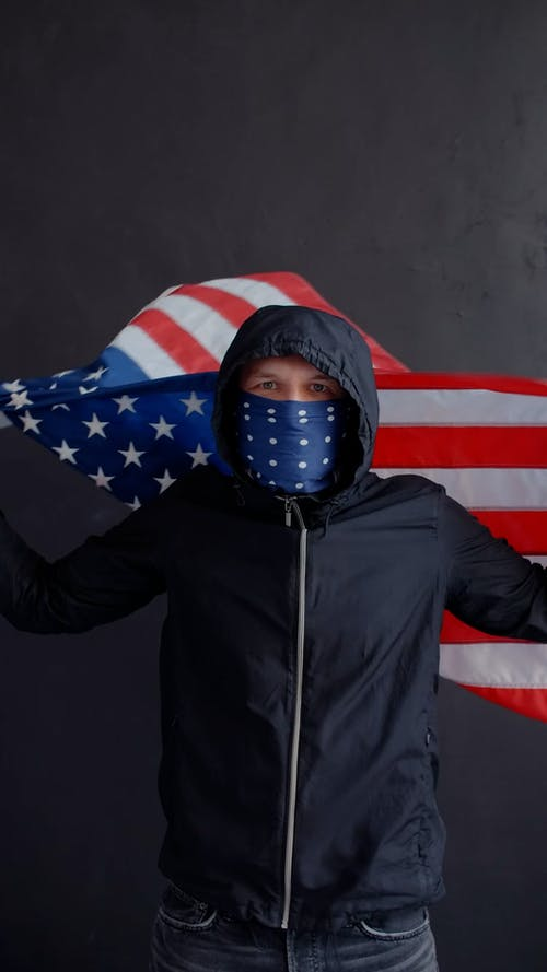 Person Wrapped in American Flag