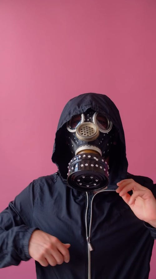 A Man Removing His Mask and Hoodie Jacket