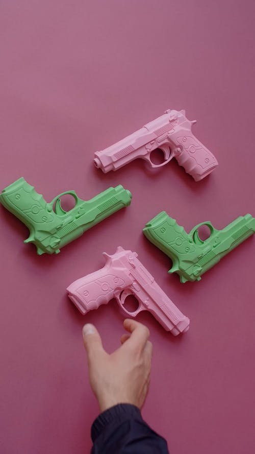 A Person Getting a Pink Gun