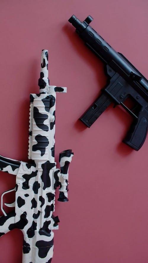 Toy Guns on Pink Background