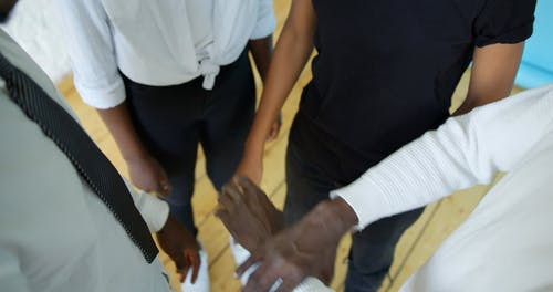 Group of People Holding Each Other's Arm