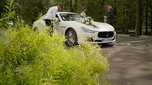 Men Fixing the Bridal Car