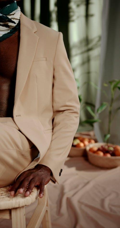 A Man Wearing Beige Suit