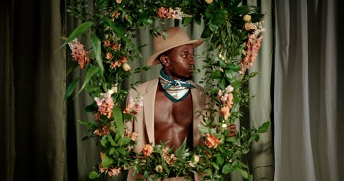 A Man Wearing a Beige Hat