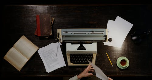 A Person Using a Vintage Typewriter