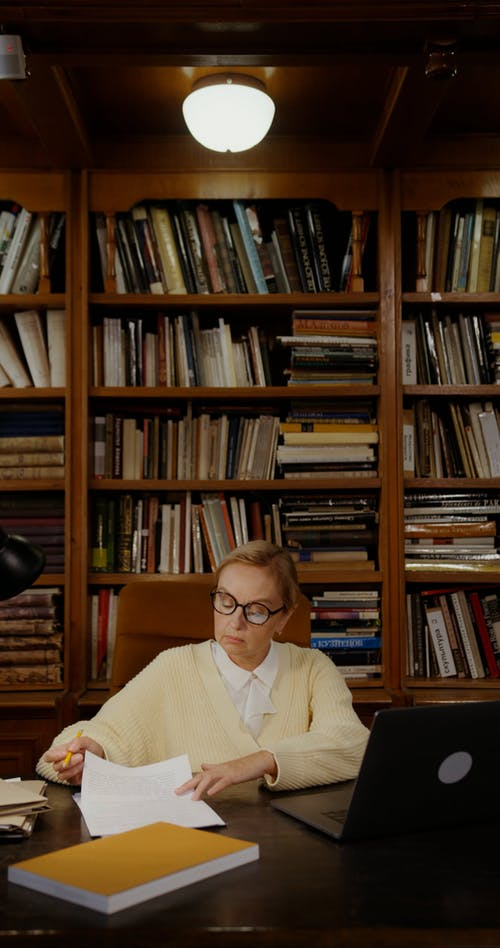A Woman Working Inside the Library